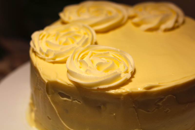 This is an image of the cake with the first rosettes piped.