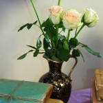 This is a close up of old books and roses.