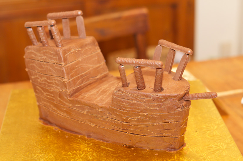 This is an image of the pirate ship cake with chocolate fingers.